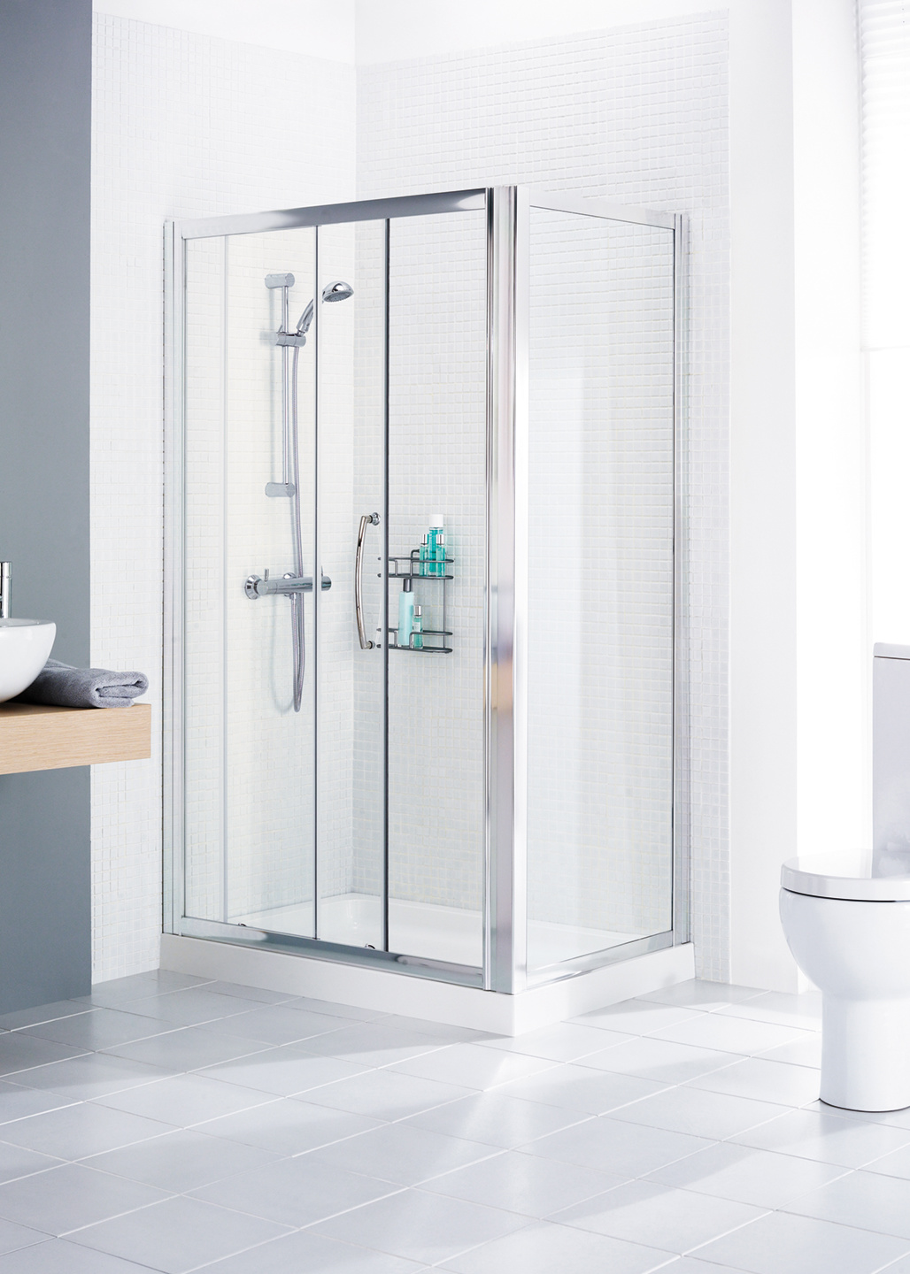 Side panel shown in situ in a framed slider door shower enclosure